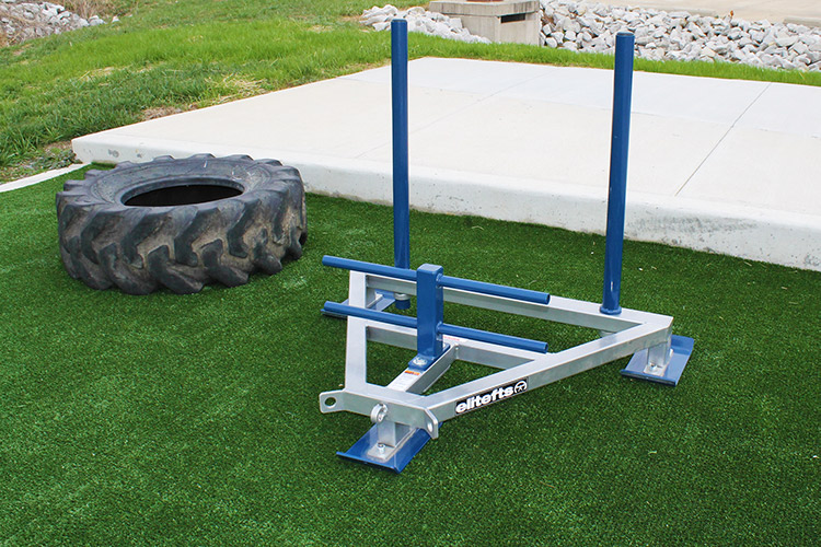 Prowler sled on outdoor turf strip.