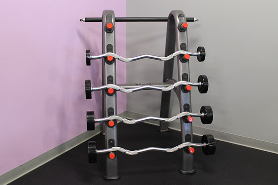 Rack with several bar weights.